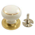 White with gold coachlines sham knob with brass rose